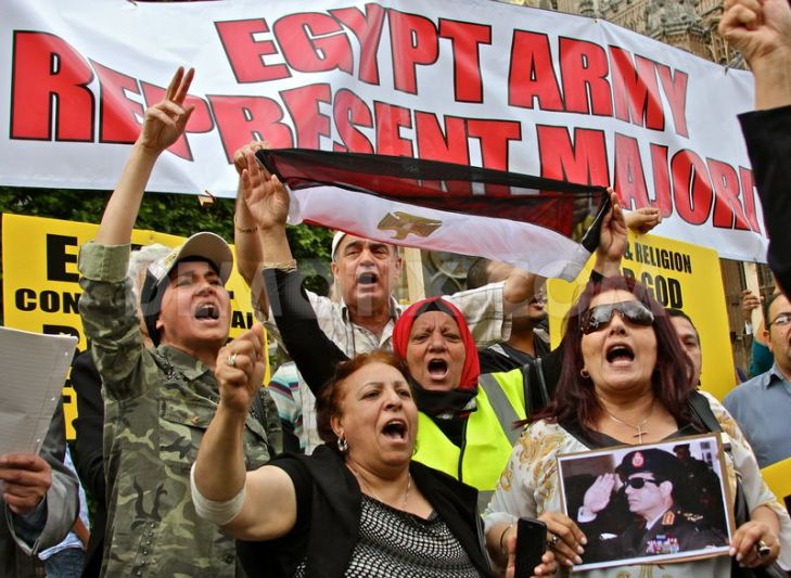 Egyptians in London demonstrate their support for the ouster of Morsi by the Egyptian Army