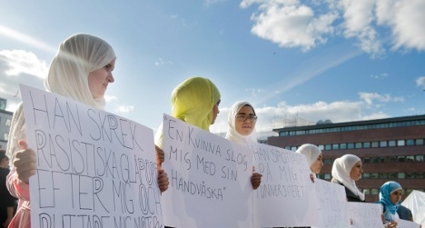 Headbag-clad Swedes take part in an anti-discrimination demo