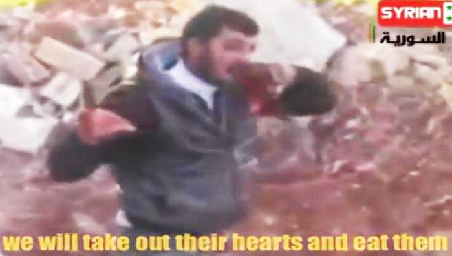 Rebelde yihadista sirio come el hígado de su enemigo