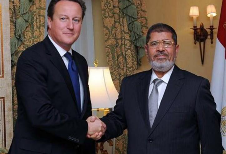 Gee, que era el año pasado de que David Cameron una calurosa bienvenida de los Hermanos Musulmanes, Mohamed Morsi como presidente de Egipto