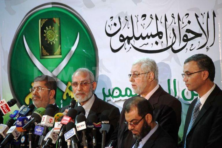 Mohammed Badie, second from left next to ousted president Mohamed Morsi