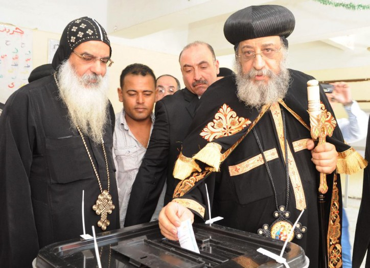 Egypt's Coptic Pope Tawadros II casts his vote in the presidential elections at a polling station in Cairo on May 26, 2014. Hailed as a saviour for overthrowing an Islamist president, former army chief Abdel Fattah al-Sisi can count on the vote of Egypt's Coptic Christians who view him as a bulwark against fundamentalists.