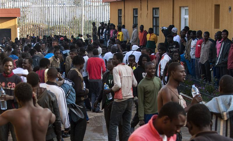 Would-be immigrants gather in the courtyard of a temporary immigrant holding center in Melilla