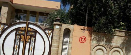 "A house in Mosul tagged with the Arabic letter ""Nun"" for ""Nassara"" (Christians in Arabic) and another with ""property of the Islamic State""."
