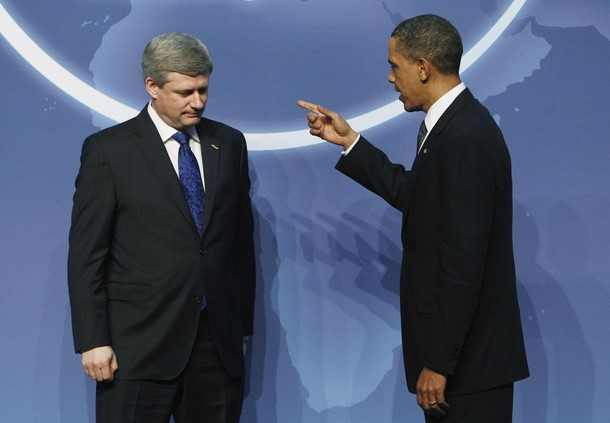 U.S. President Obama greets Canada's Prime Minister Stephen Harper at the Nuclear Security Summit in Washington