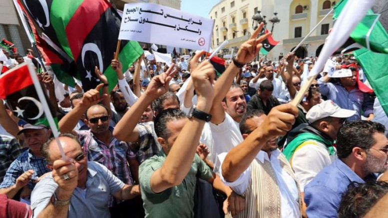 Libyan protesters hold a demonstration demanding the departure of militias on July 7, 2013, in Tripoli. The protesters thronged Algiers Square in the capital from mid-morning to demand the implementation of a General National Congress order for militias to withdraw from the city.AFP