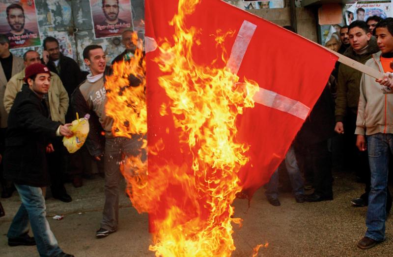 Muslims burning the Danish flag over the Mohammed cartoons