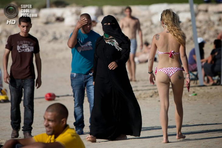 Muslim women on the beach