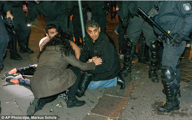 1412762746839_wps_27_An_injured_protestor_gets