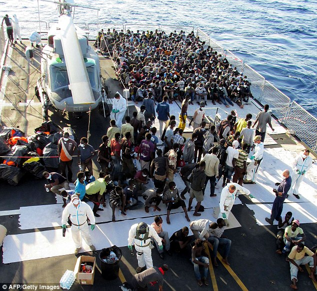 1414488155873_wps_23_Rescued_migrants_aboard_t