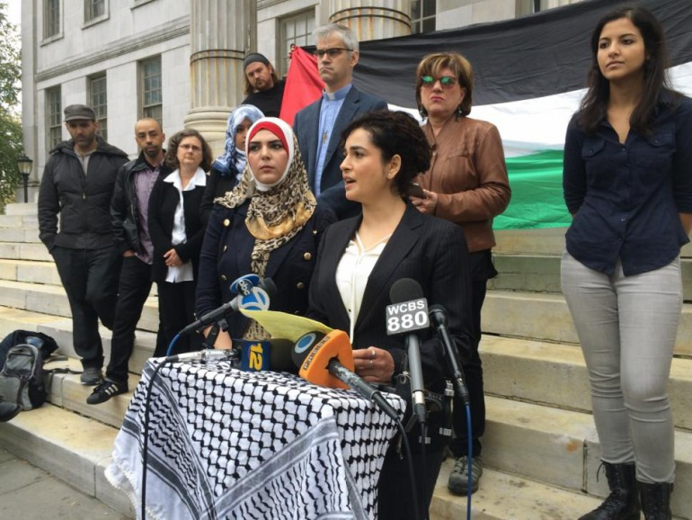 Lawyer Lamis Deek, flanked by Nerdeen Kiswani to her right, says that Kiswani was the victim of a hate crime at the Barclays Center.