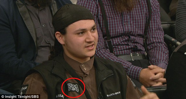 "Sulaymin Khalid (Abu Bakr), wearing a shirt adorned with an ISIS patch, says the Canadian government should stop ""picking on Muslims"""