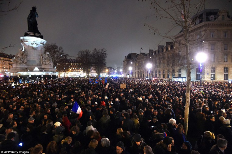 Protesters at the Place de la Republique in Paris tonight, following an attack by gunmen on the offices of Charlie Hebdo