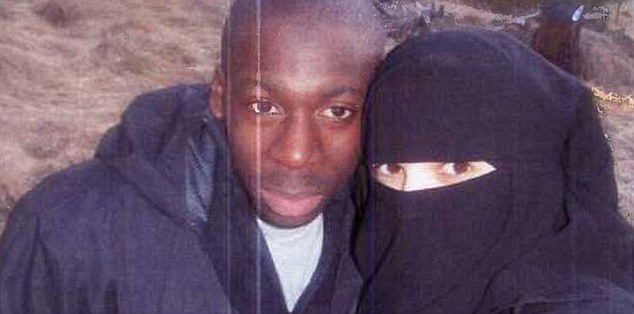 Boumeddiene (right) walked away from a low-paid job as a cashier in 2009 and started wearing a veil. She 'devoted herself' to Coulibaly (left)