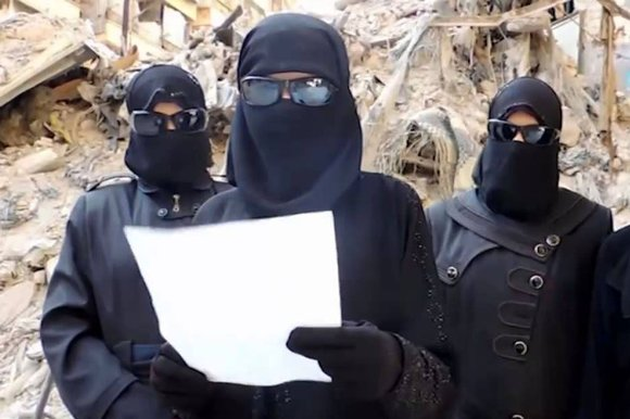 Female Isis supporters in Syria. The terror group employs an all-female militia to uphold its interpretation of sharia among women and to mete out punishments