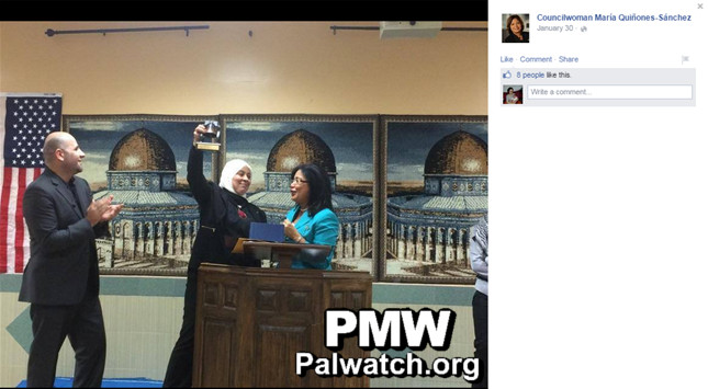 Philadelphia Councilwoman Maria Sanchez with Laila Ghannam,  holding up the Liberty Bell award