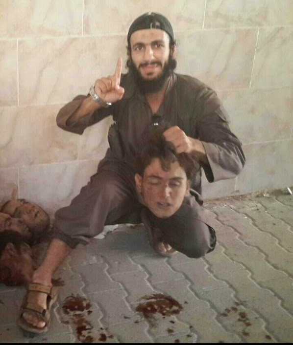 Mohamed Elomar, a former Australian boxer, was pictured recently grinning widely as he posed with decapitated head