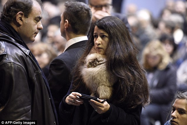Charlie Hebdo columnist Zineb El Rhazoui, 33, (centre) has been suspended by the satirical magazine