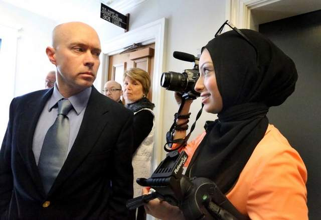 Micah Forrest,left, stares down and blocks Maryland University Muslim Journalism student Noor Tagouri from filming outside the courtroom where opponents are challenging the Islamic Center of Murfreesboro cemetery approval by the Rutherford County Board of Zoning Appeals