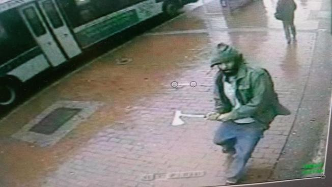 The hatchet-wielding Muslim 'jihad warrior' who attacked four NYPD officers and was then shot dead by police  allegedly had ties to ISIS.