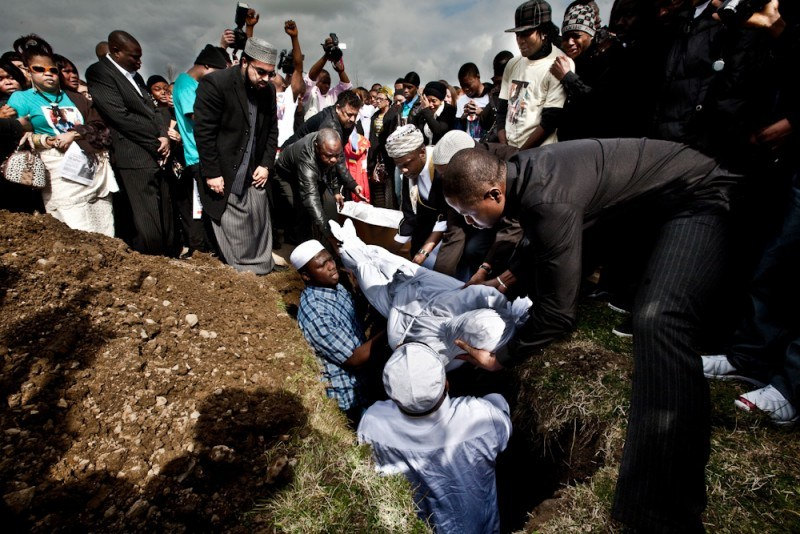 Muslims bury their dead in white sheets, with no caskets
