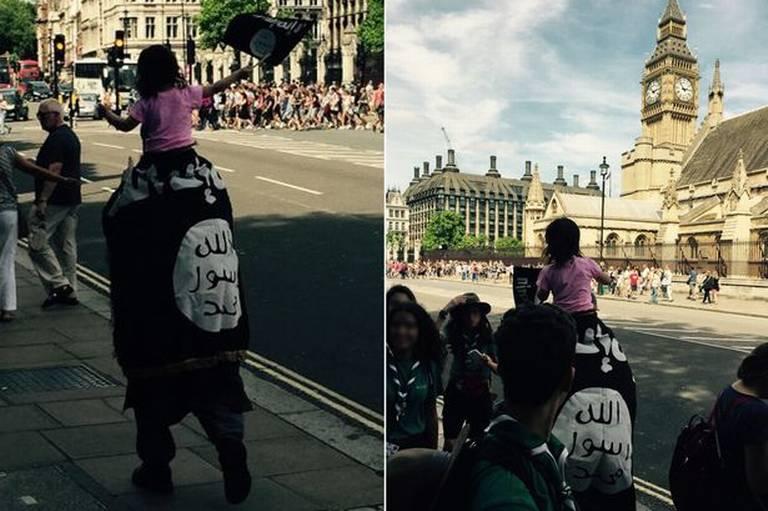 MAN desfiles MUSULMANES cerca de Big Ben envuelto en la bandera de ISIS, niño en el hombro parpadea banderita