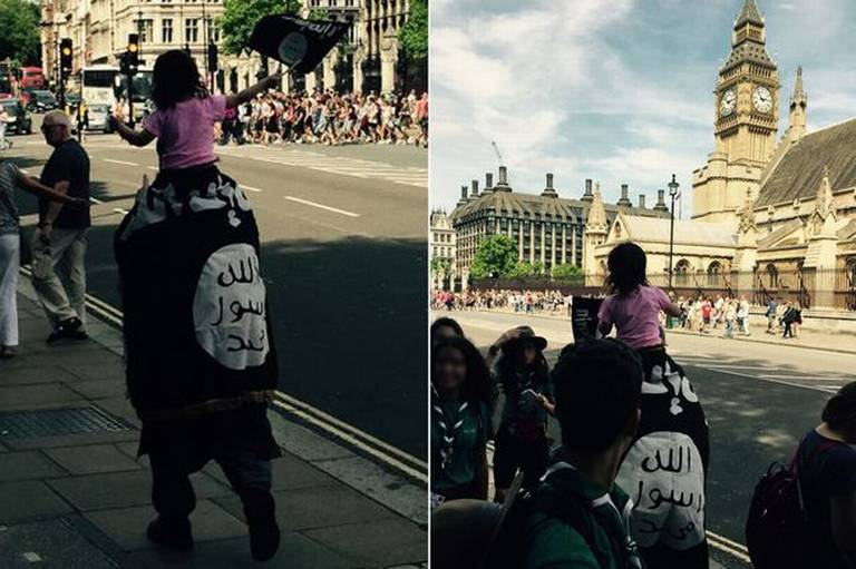 MUSLIM MAN parades near Big Ben draped in ISIS flag, child on shoulder flashes little flag
