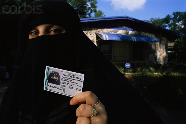 American Muslim Woman Showing Driver's License