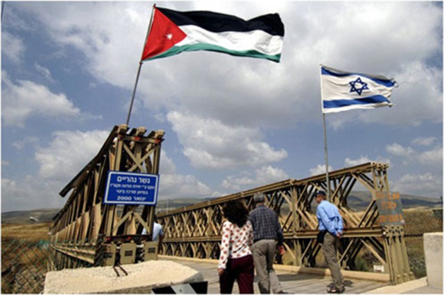 Jordanian and Israel flags fly side by side at Peace Park