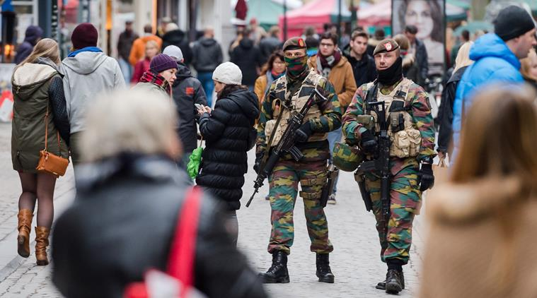Soldiers from the Belgian army patrol in the picturesque Grand Place in Brussels on