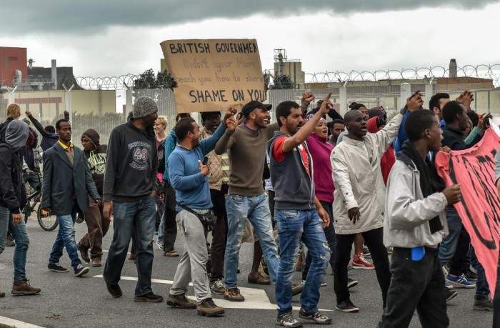 Illegal alien migrants demonstrate against British government