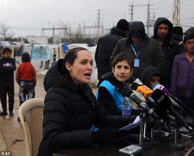 Angelina Jolie today held a press conference at a refugee camp in Lebanon as she attacked the 'tragic' failure to resolve the Syrian war which has forced millions to flee their homes