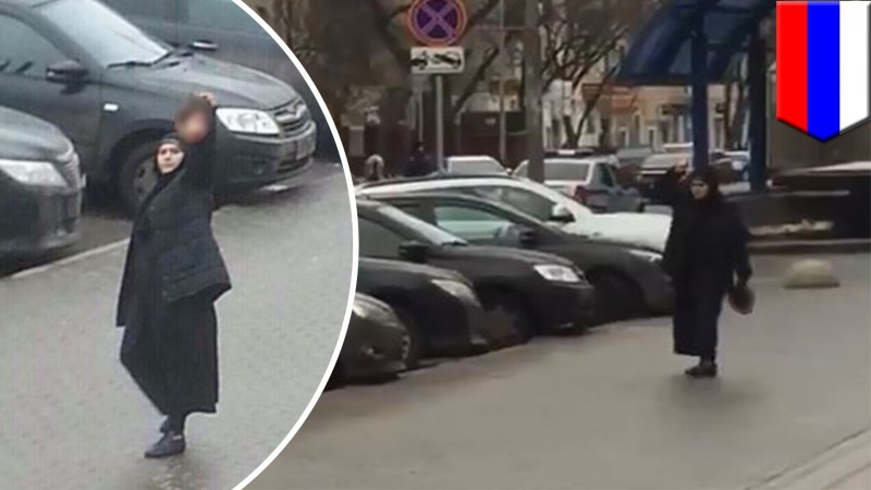 Gulchekhra Bobokulova marching in the streets with the child's severed head