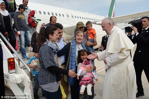 Pope Francis greeted the three Syrian MUSLIM families he rescued from a refugee camp on the Greek island of Lesbos