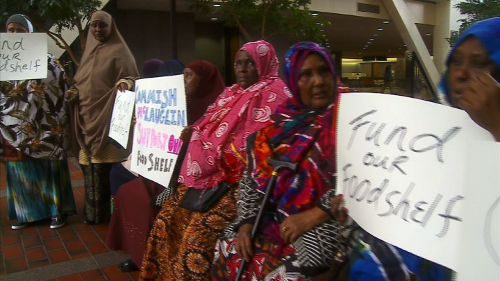 OBESE SOMALI MUSLIM immigrants demand more funding for the halal-compliant free food bank in Minneapolis