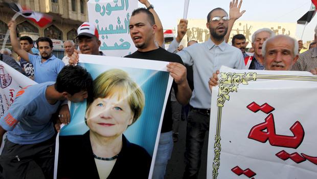 Merkel might be beloved in Iraq, Berlin, not so much