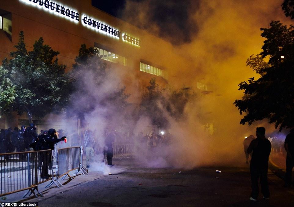 349646E300000578-3607997-Riot_police_pepper_spray_Trump_protesters_outside_the_Albuquerqu-a-40_1464151223452