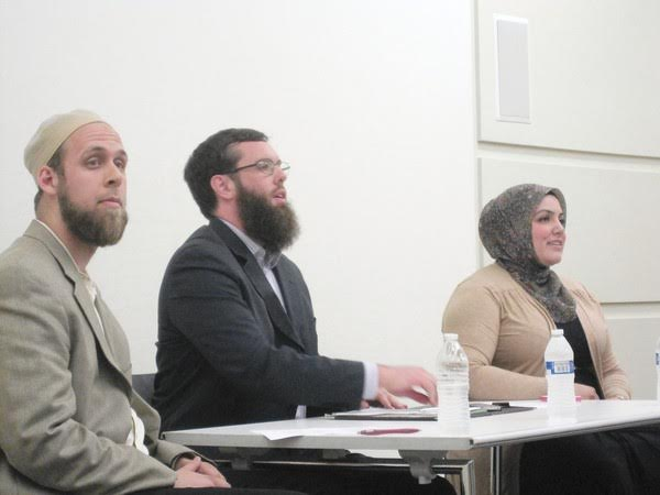 From left, Amir Toft, Thomas Maguire and Iman Sedique speak about their Islamic faith at the Orland Park Public Library Thursday. The forum often turned tense as some audience members expressed their distrust of Muslims.