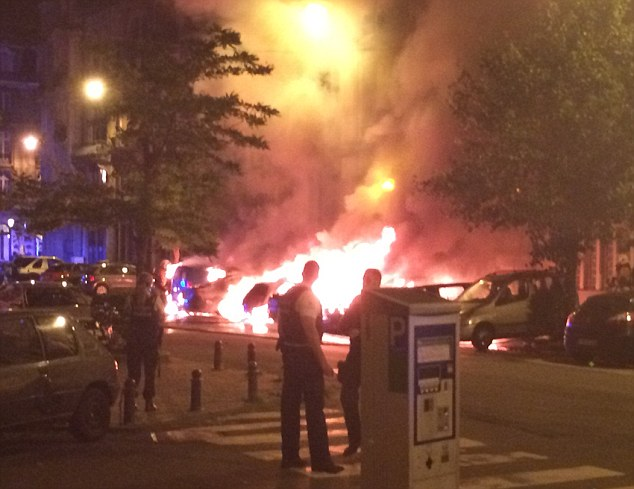 A large section of Brussels city centre has been closed off after several cars burst into flames, pictured +4 A large section of Brussels city centre has been closed off after several cars burst into flames