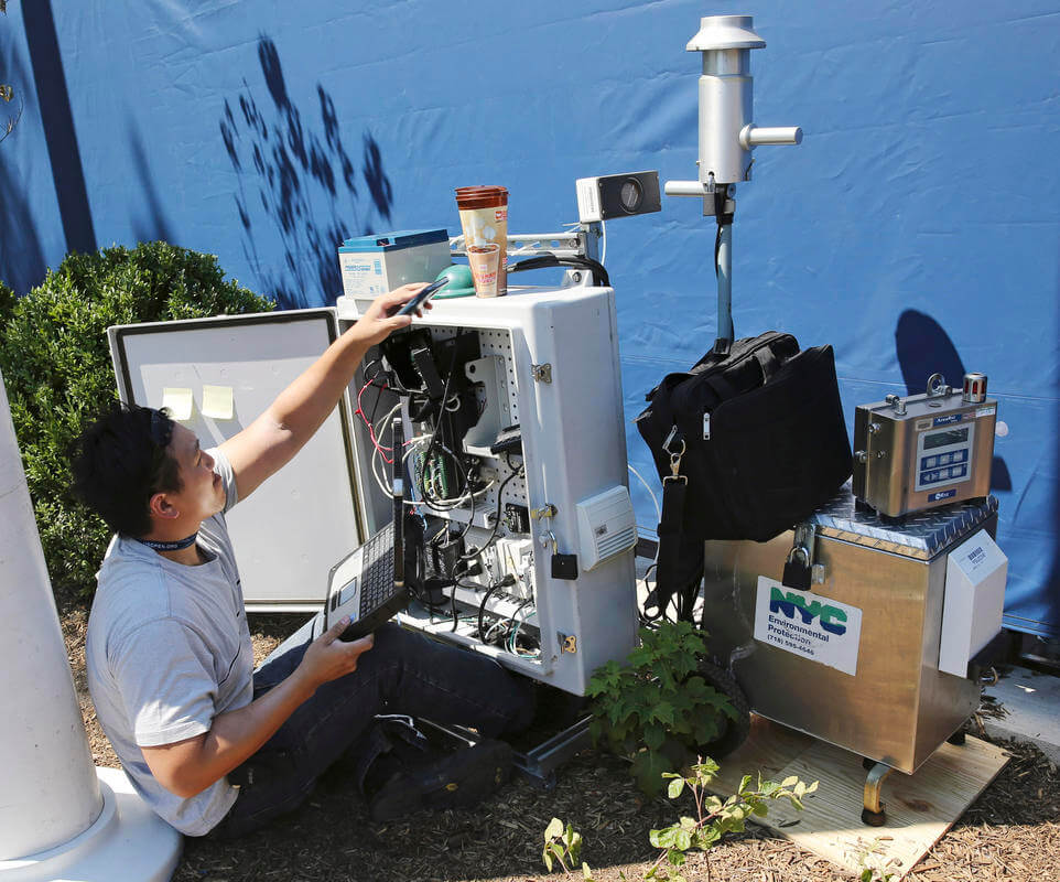A technician programs a radiation detection device at the entrance to the the Billie Jean King National Tennis Center in New York.