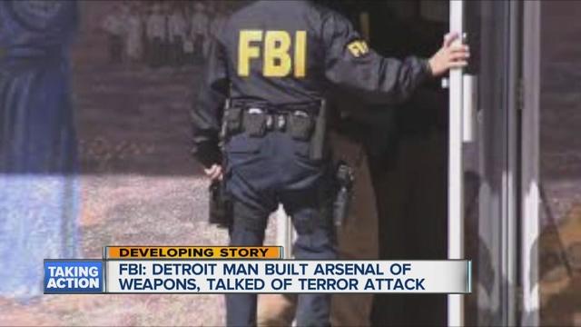 Man_amassing_arsenal_of_guns_and_grenade_0_43586986_ver1.0_640_480