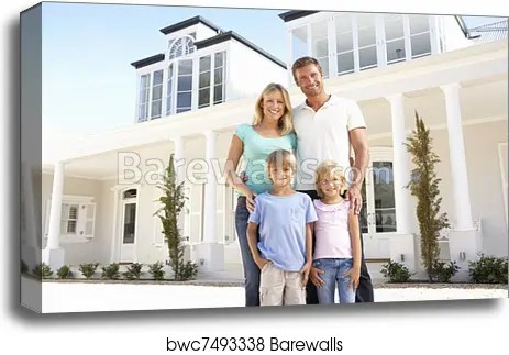 young family standing outside
