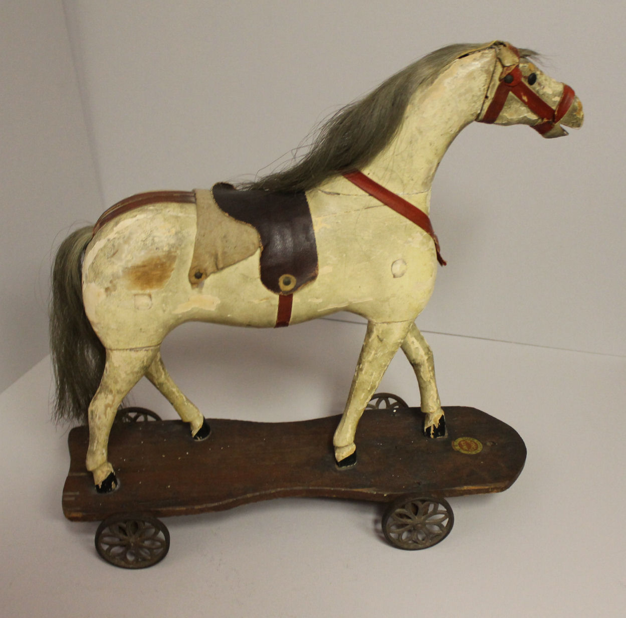 Bargain Johns Antiques  Wood Horse on platform Pull toy