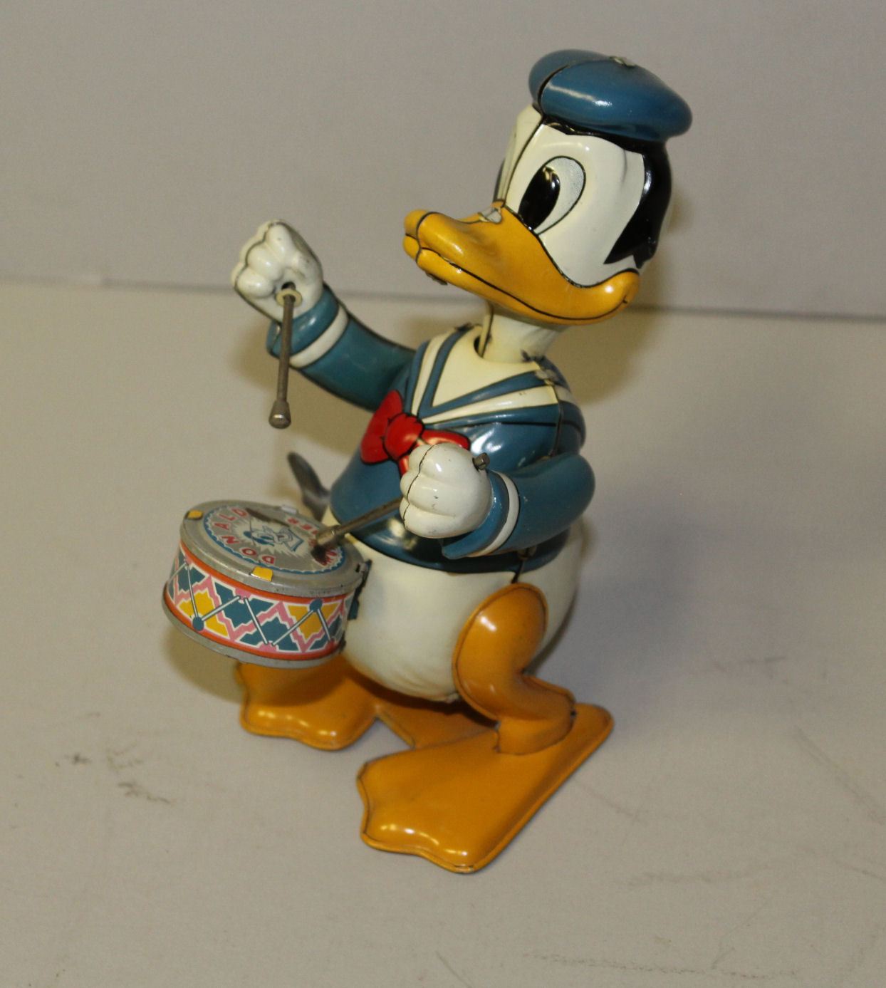 Bargain Johns Antiques  Antique toy Donald Duck Tin Wind Up Walking Drummer Line Mar Toys