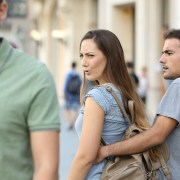 Disloyal woman looking at another man