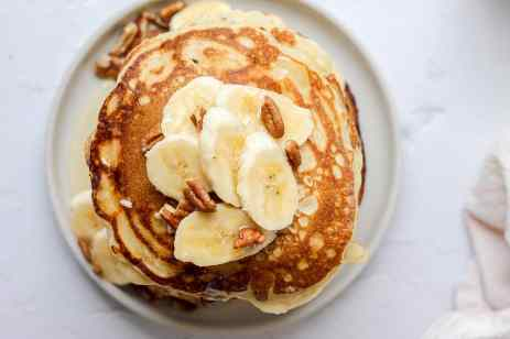 sourdough pancakes with sliced banana and pecans