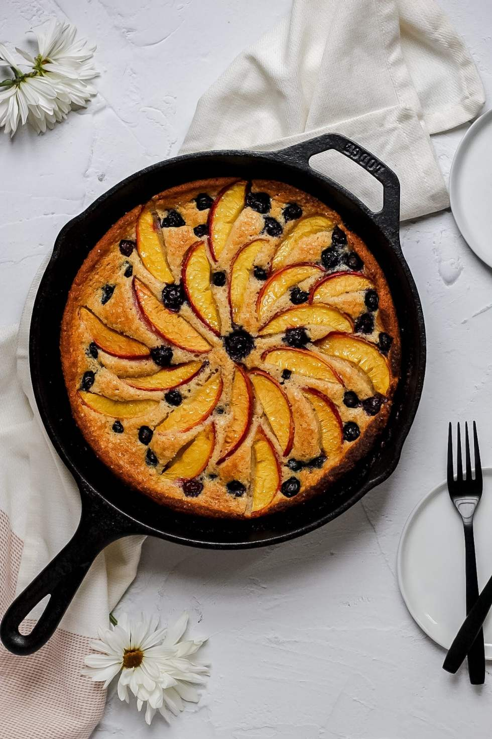 peach blueberry cobbler in cast iron pan after baking