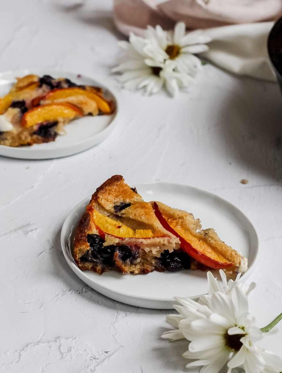 slice of peach blueberry cobbler