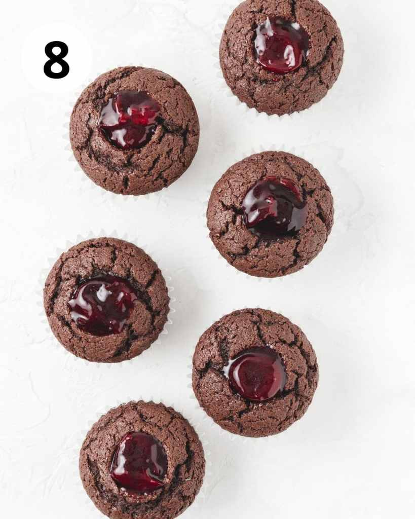 chocolate cupcakes with middles cut out and filled with homemade cherry filling