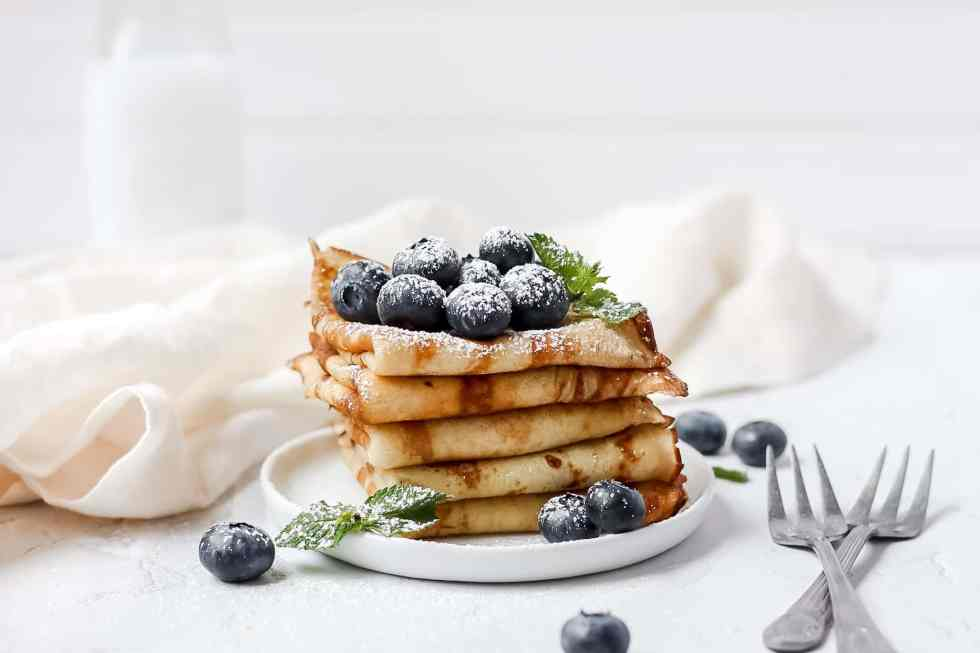sourdough crepes with fresh blueberries and powdered sugar